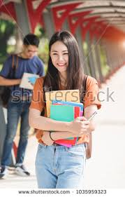 classmates book woman girl student hold note stock photo 1035959323