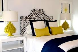 navy white and yellow bedroom could do without the lamps this