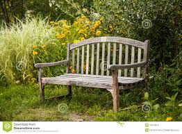old wooden bench in garden stock images image 34610824