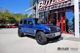 matte blue jeep jeep wrangler with 20in black rhino sidewinder wheels exclusively