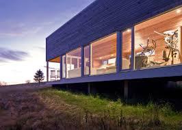 architects add zen like timber spa and gym to coastal nova scotia