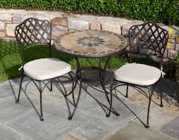 dining room mosaic bistro table with black legs and double chairs