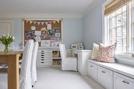 Pink Craft Room - craft room with built in window seat transitional den library