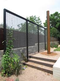 modern trellis with creeper to act as garden room divider