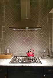 290 best countertop backsplash trends images on pinterest amazing herringbone patterned backsplash using smoke glass subway tile gorgeous