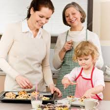 family women baking cupcakes in kitchen u2014 stock photo