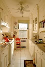 kitchen galley kitchen layout in white with crown molding via