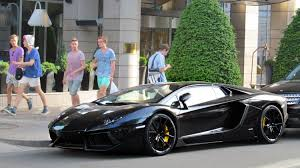 black lamborghini aventador roadster in hungary