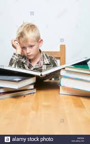 Student At Desk by Little Child Blond Focused Student Boy Sitting At Desk And Reading