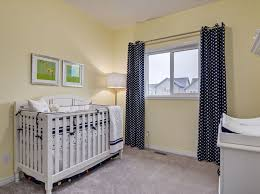Crib Bedding Calgary An Adorable Nursery Painted A Pale Yellow With Starry Curtains And