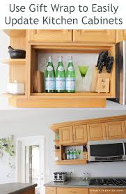 Kitchen Cabinet Update by Simple Is Pretty Using Gift Wrap To Update Kitchen Cabinets
