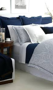 articles with white duvet cover with navy blue trim tag