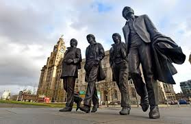 why is ringo a step behind the other fab four statues liverpool