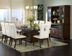 frantic room with dark brown table also white dining chairs plus simple chandelier