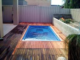 Backyard Pool Cost by Fiberglass Pools Pros And Cons