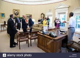 president barack obama meets with senior staff in the oval office