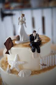 wedding cake toppers and groom fishing cake toppers from our wedding with halibut and