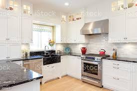 kitchen design white cabinets granite contemporary classic home kitchen design featuring granite countertops white cabinets stock photo image now