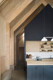 the 25 best plywood cabinets ideas on pinterest plywood kitchen forstberg ling house for mother soaring scandinavian kitchen in natural and stained plywood with exposed beams