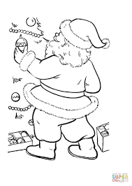 santa is decorating christmas tree coloring page free printable