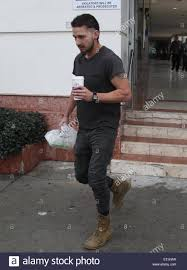 shia labeouf sporting a new rattail style haircut grabs himself