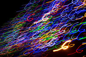colorful electric lights in motion black stock illustration