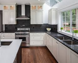 black and white kitchen backsplash white hanging cabinet finish patterned black granite countertop