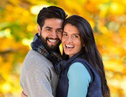 Muslim dating couple embracing in fall EliteSingles