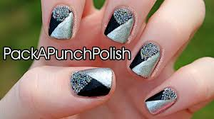 black and silver pattern nails with caviar nail art