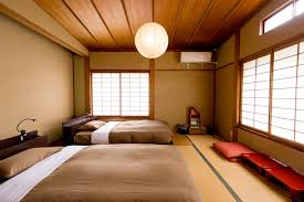 attractive hostel has wooden bed with white mattras it also has