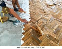 laminate parquet floor installation by white stock photo 522520276