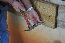 decks com ledger board attachment to a solid concrete foundation wall