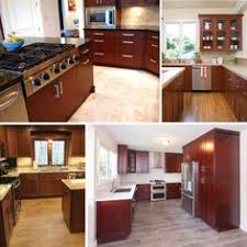 Gray Wood Floors Warm Cherry Cabinets White Counters - Cherry cabinet kitchen designs