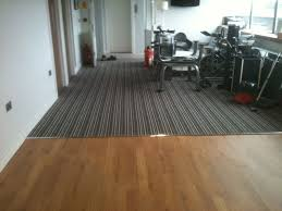 Laminate Floor Contractor Floor Installation Services Commercial Flooring Services Gym