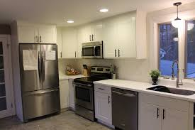 white wooden kitchen cabinet on ceramics flooring plus steel sink