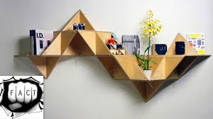 interior unique beige modern solid wood cubed wall bookcase plant