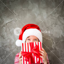 xmas gift funny child holding christmas gift portrait of happy kid wearing