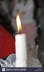 baptism candle lighted baptism candle stock photo 56012518 alamy