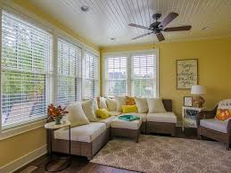 cottage living room with ceiling fan u0026 carpet in johnston ia