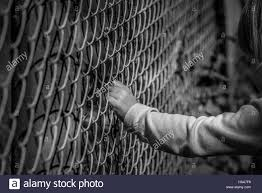 Black And White Drama by Black And White Image Of A Little Hand Grabbing A Metal Fence