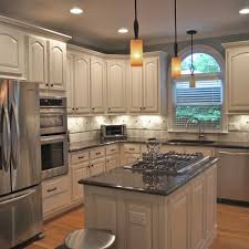 white kitchen cabinets with cathedral doors what our kitchen could look like if we keep our cathedral