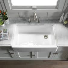 bathroom white kohler sinks plus silver kitchen faucet for