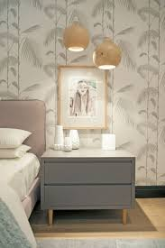 bedroom with wallpaper and hanging bedside lamps proper heights bedroom with wallpaper and hanging bedside lamps