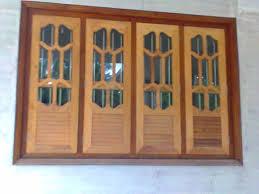 kerala style carpenter works wooden window door front door designs