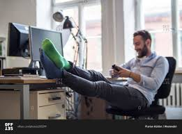 Feet On The Desk Young Man In Office With Feet On Desk Wearing Different Socks