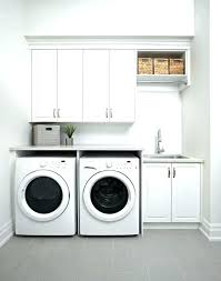 Laundry Room Storage Between Washer And Dryer Between Washer And Dryer Cabinet Laundry Room Cabinets Washer