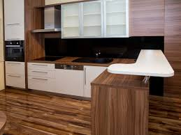 nice small kitchen design with wooden countertop and white table