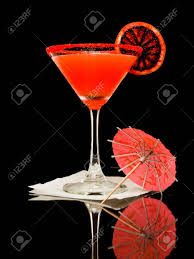blood orange color martini isolated on a black background with