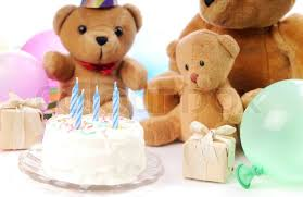 teddy balloons teddy bears with party hats balloons and a cake isolated on a white