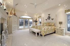 and luxurious master bedroom with a sitting area and fireplace bedroom
